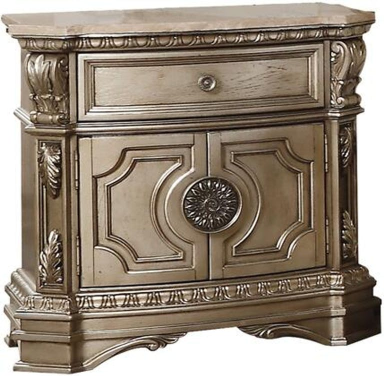 Product Photo: Northville Collection Nightstand with 1 Drawer 2 Doors Oversized Acanthus Leaves Silver Grey Metal Hardware Poly Resin Carved Molding Trim and Wood Veneer Materials in Antique Champagne Finish 26935